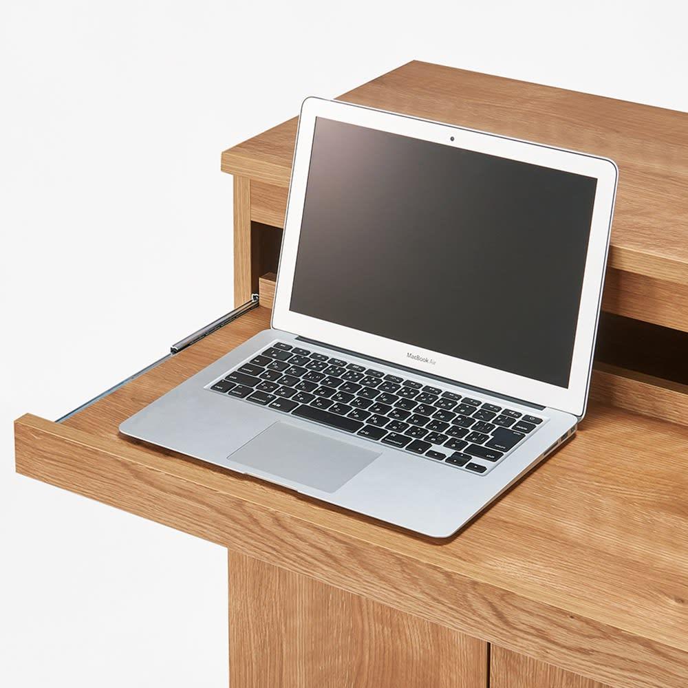 スライドテーブル付きカウンター下収納庫 幅120cm 天板を引き出せば、広々とした奥行30cmのテーブルに。