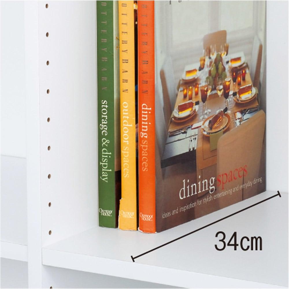 光沢仕様 引き戸壁面収納本棚 幅120奥行40突っ張り上置き高さ55~70(本体52)cm 奥行40cmの深型は雑誌や辞書、書類の収納に。