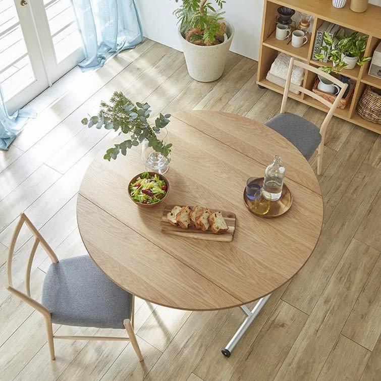 丸形昇降バタフライテーブル幅100 (イ)ナチュラル 天板はオーク天然木突板を使用しており、木目のラフな素材感が北欧インテリアを引き立てます。