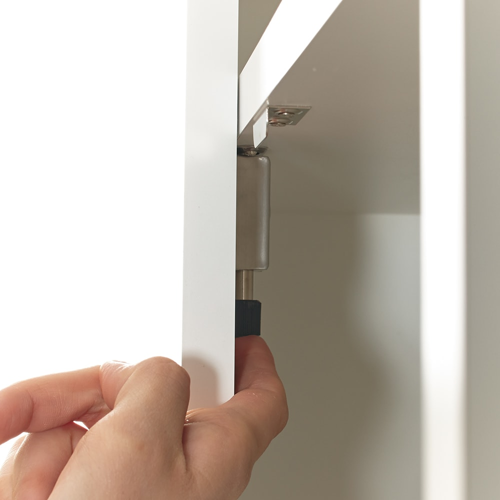鍵付き本棚ハイタイプ 幅60奥行45高さ180cm 左の扉は、内部にあるストッパーを解除して開きます。鍵は2本が付属。