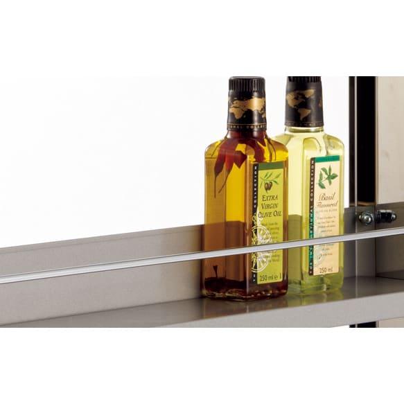 ステンレスすきま収納シリーズ ロータイプ(高さ84cm) 幅10奥行61cm こぼれ止めバー付き。逆側は棚板の立ち上がりで落下を防止。 棚板は6cmピッチで可動します。