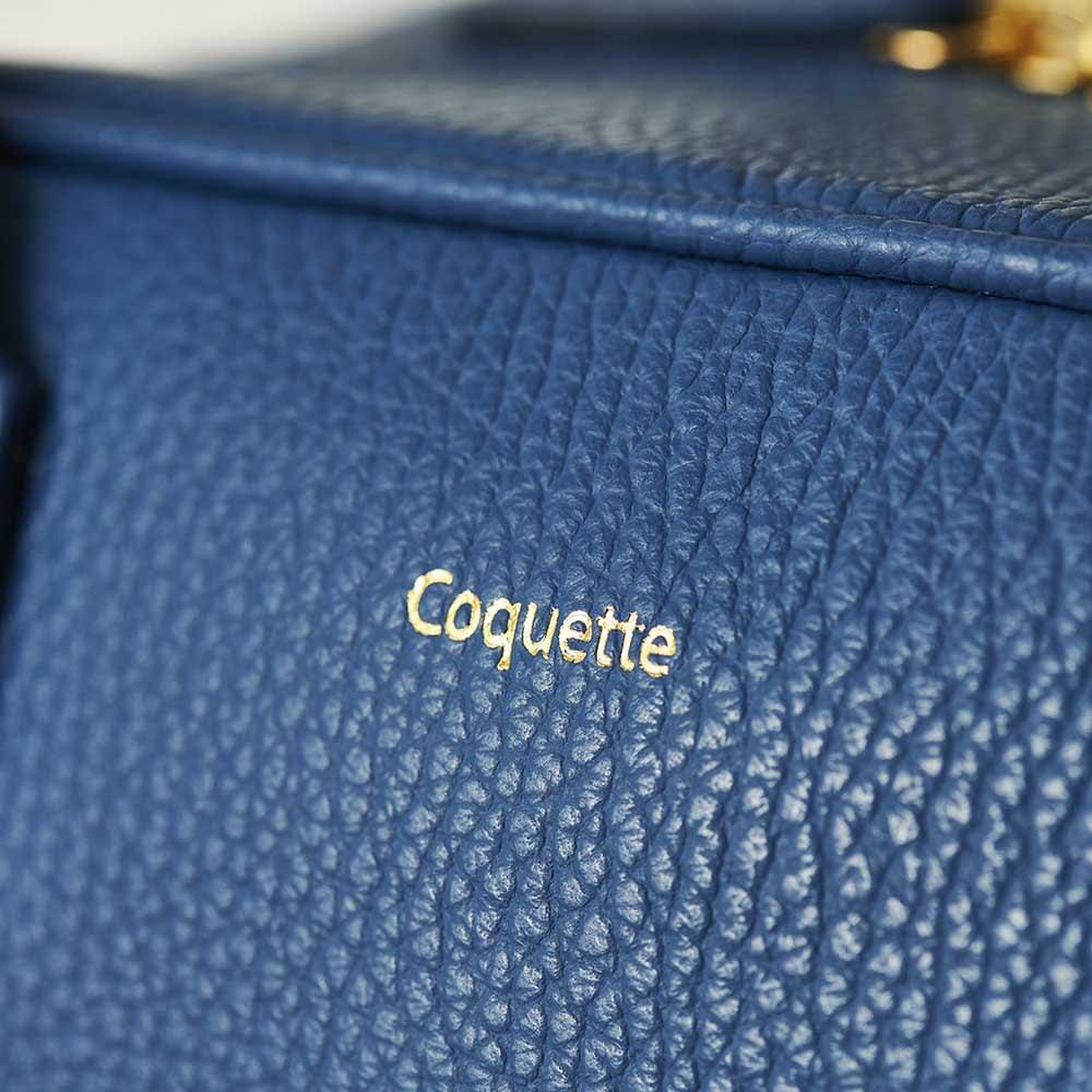 Coquette/コケット キュービック バッグ dinos限定カラー ゴールドのブランドロゴがエレガントに映えます。