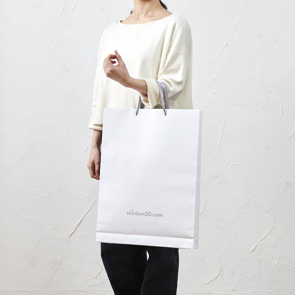 お誕生日新聞 喜寿(77枚セット) ぴったりサイズの特製手提げ紙袋をお付けします。差し上げる時の持ち運びに便利です。