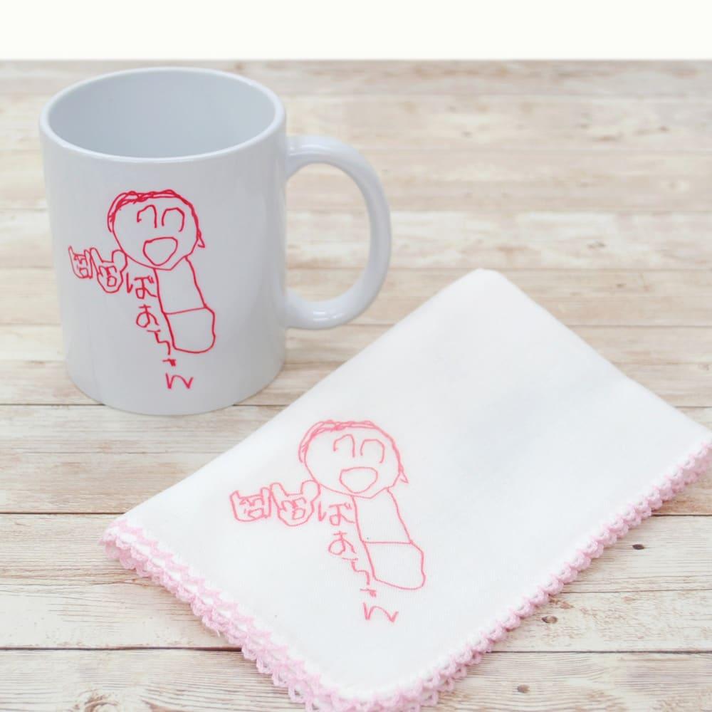 似顔絵 お仕立券 オーダーハンカチ&マグカップ (エ)ピコット刺繍ピンクハンカチセット マグカップとハンカチのセットです。