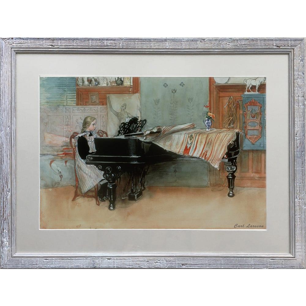 カール・ラーション/ピアノの少女(スウェーデンアート) ラーションの暖かな色合いと繊細なタッチを引き立てる額入りです。