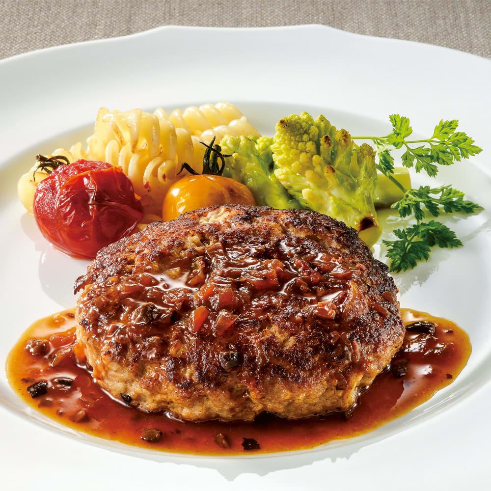 落合務シェフ監修 牛肉100%のハンバーグ(黒トリュフソース) (150g×6個) 肉汁たっぷりのハンバーグは余分な調味料は使わずに仕上げ、ワインを使ったソースに黒トリュフを入れた風味豊かなソースをかければ、こだわりハンバーグの完成です。