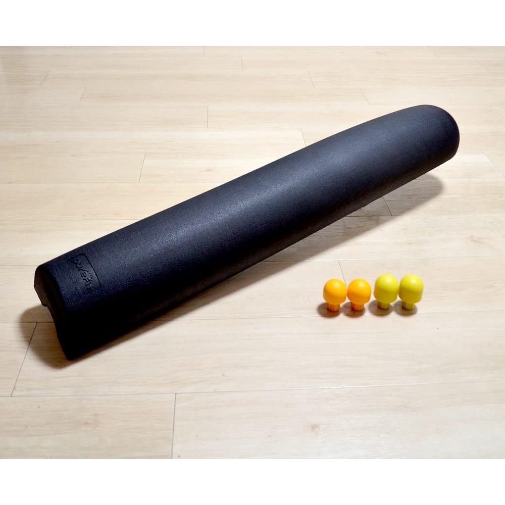 ピュアフィット リストレッチボディ 大小の「押し球」をセット。これを裏側にセットすると、ガチガチに凝り固まった肩や腰の筋肉のケアにも!