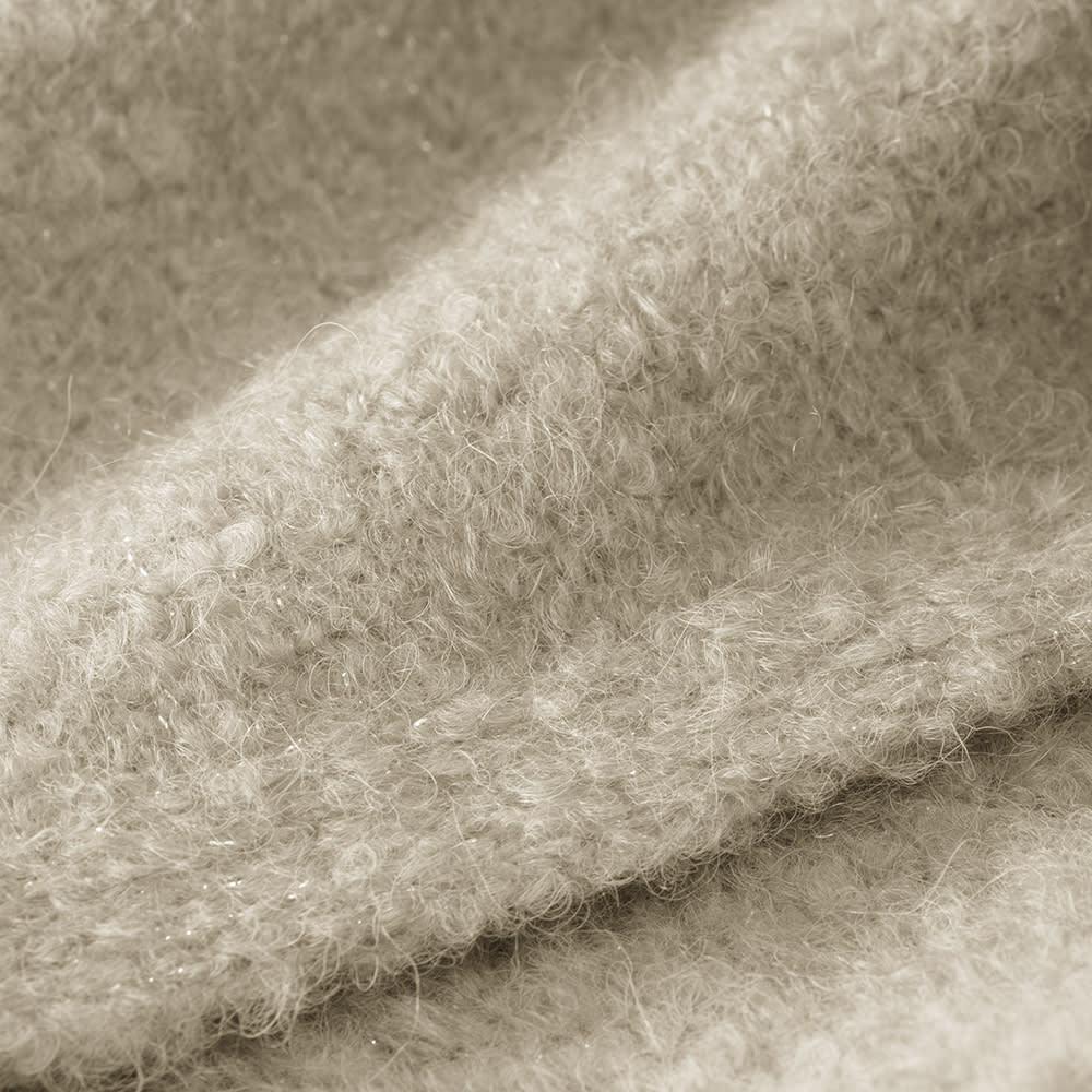 """アルパカブークレ コーディガン 欧米のトップブランドが採用するほどのペルーの老舗メーカー""""ミッチェル社""""の上質アルパカ糸を使用。さらに羊毛の中でも特に肌触りが柔らかく上質な「メリノウール」をブレンドすることで型崩れを防ぎました。"""
