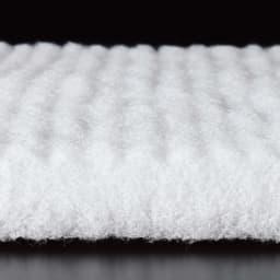 魔法の敷布団 たった約1.5cmで強力にサポート! テイジンの高機能クッション素材V-Lap(R)を中素材に使用。特殊なタテ構造の繊維による優れた反発力が腰や背中をしっかり支えます。丈夫でヘタリにくいのもうれしい! タテ方向に並んだ繊維がバネのように反発し、全身サポート。