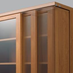 本格仕様 快適スライド書棚 タモ天然木扉付き・上置き付き 3列 【軽い力でなめらかに動くベアリング式】サビや磨耗に強く、1個で約465kgに耐える特殊ベアリングローラーを採用。レール上のステンレス芯と点で接するので、静音でなめらかに動きます。