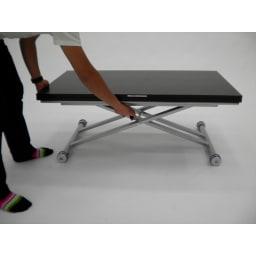 伸長式ガス圧昇降テーブル 幅100(天板90)cm 天板下のレバーを引きながら昇降させます。