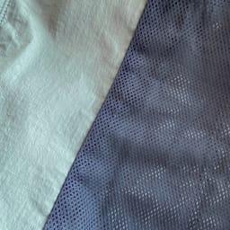 異素材切り替え ギャザーブルゾン 裏地はグレーのメッシュ仕様。