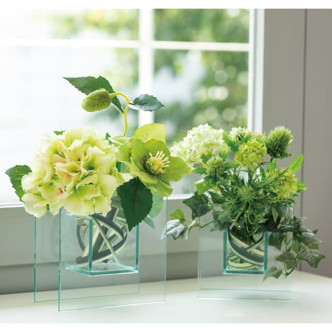CT触媒加工テーブルフラワーアレンジ お得な2点セット 大小2点セット スクエアでモダンな透明感のあるガラスベースに仕立てたCT触媒のフェイクグリーン。瑞々しい質感が、テーブルを華やかに彩ります。グリーンを取り外して、花瓶としても使えます。